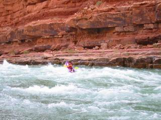 Joel is running the North Canyon Rapid in this inflatable kayak.  It looks pretty exciting and a little scary.
