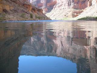 I sit in the boat looking down at the canyon.