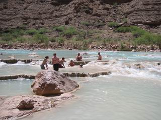 People playing in the mud pool in the Little Colorado River.