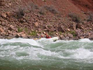 Will's boat brushing by the big hole in Hance Rapid.